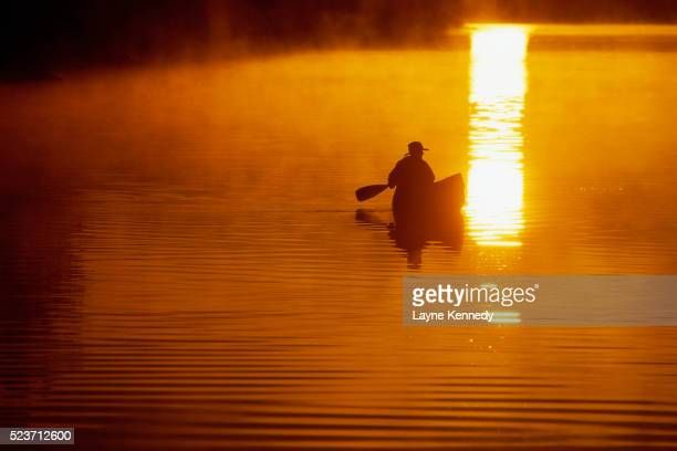 man canoeing at sunrise - boundary waters canoe area stock pictures, royalty-free photos & images