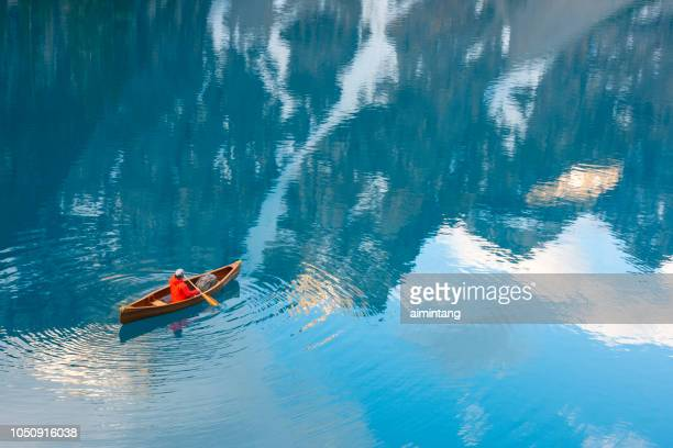 a man canoeing in moraine lake - moraine lake stock pictures, royalty-free photos & images