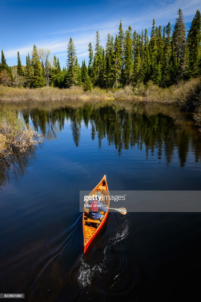 Man canoeing on the river : Stock Photo