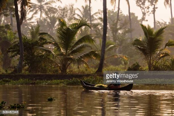 Man canoeing on tropical river