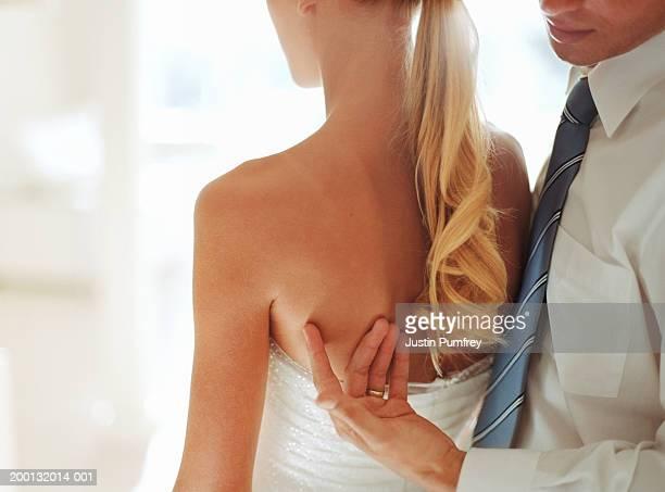 Man caressing woman's back, close-up