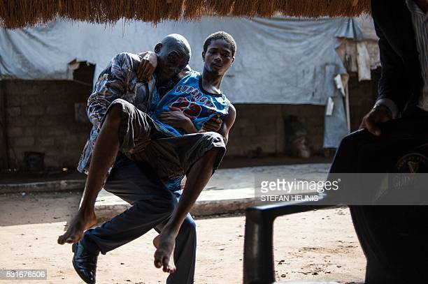 A man carries a 19yearold student that got shot during a proBiafra protest in 2015 in Aba Nigeria on May 3 2016 Over the past year Biafran...