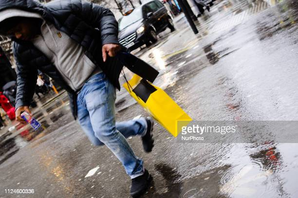 A man carries a bag from Selfridges department store along Oxford Street on a wet afternoon in London England on February 8 2019 February 15 sees the...