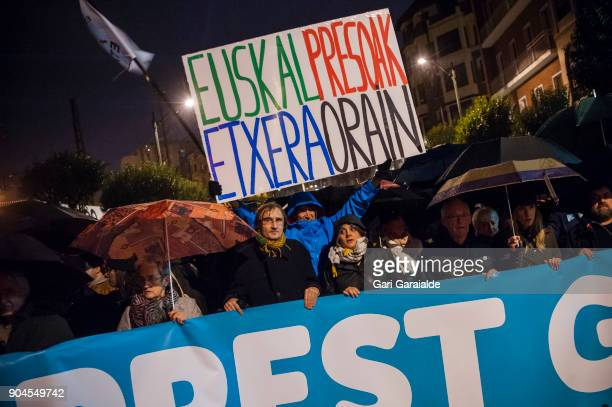 A man carries a banner reading 'Bring home Basque prisoners now' as he take part in a demonstration organised by the citizen's network which is...