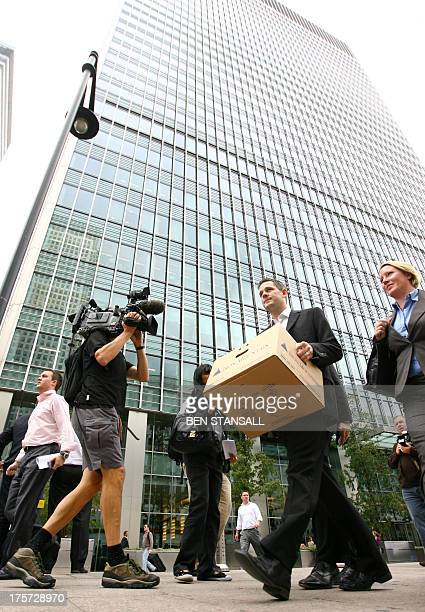 A man carries a box after leaving the Lehman Brothers European Headquarters building in Canary Wharf in east London on September 15 2008 The British...