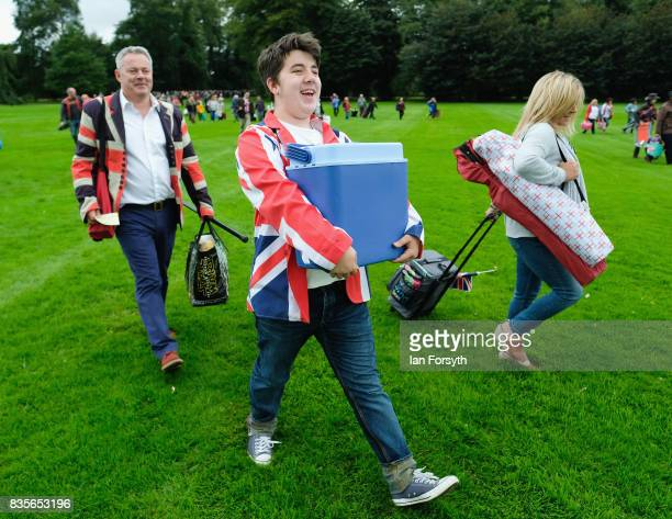 A man carries a cool box as he arrives for the annual Castle Howard Proms Spectacular concert held on the grounds of the Castle Howard estate on...