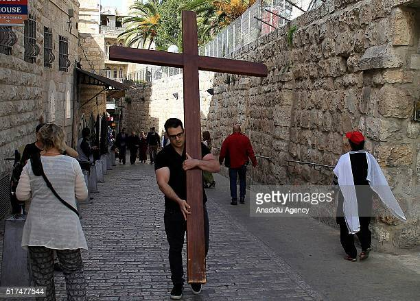 A man carries a cross on the Via Dolorosa a path that Jesus walked on the way to his crucifixion during the Good Friday ahead of the Easter in...