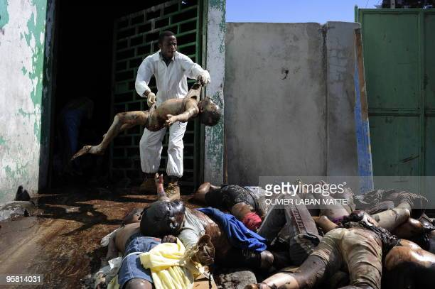 A man carries a dead body at the morgue of the general hospital January 15 2010 at Port Au Prince following the 70magnitude quake on January 12 More...