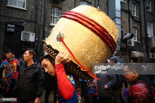 A man carries a drum after performing a dragon dance in China Town during Chinese New Year celebrations on February 19 2015 in London England This...