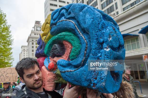 A man carries a giant cut out of a brain at the March for Science on April 14 in downtown Portland OR