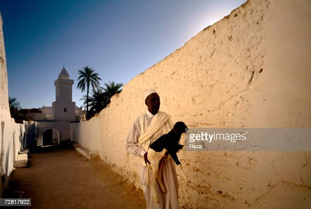 A man carries a goat at the entrance of the old district called 'The Slaves Quarter' April 25 2000 in Ghadames Libya