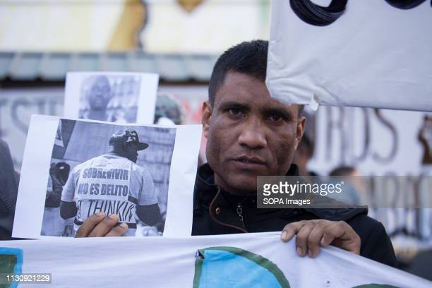Man carries a picture of Mame Mbaye when he went to the protests against racism and to demand residence permits for all Protest against institutional...