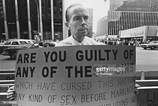 A man carries a placard reading 'Are You Guilty Of Any Of These Sins' in Midtown Manhattan New York City 1976