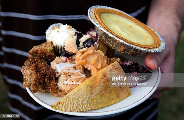 Man carries a plate of high calorie, unhealthy, sugary, fattening desserts: cakes, key lime pie, and a healthy piece of cantaloupe.