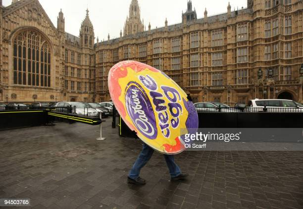 A man carries a poster of a giant Cadbury Creme Egg following a protest organised by the Unite union outside the Houses of Parliament on December 16...