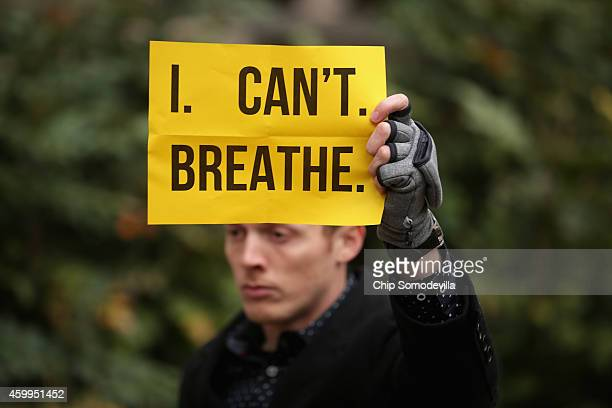A man carries a sign with some of Eric Garner's last words I can't breath in protest against recent decisions by grand juries in the Michael Brown...
