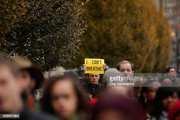 """Man carries a sign with some of Eric Garner's last words, """"I can't breath,"""" in protest against recent decisions by grand juries in the Michael Brown..."""