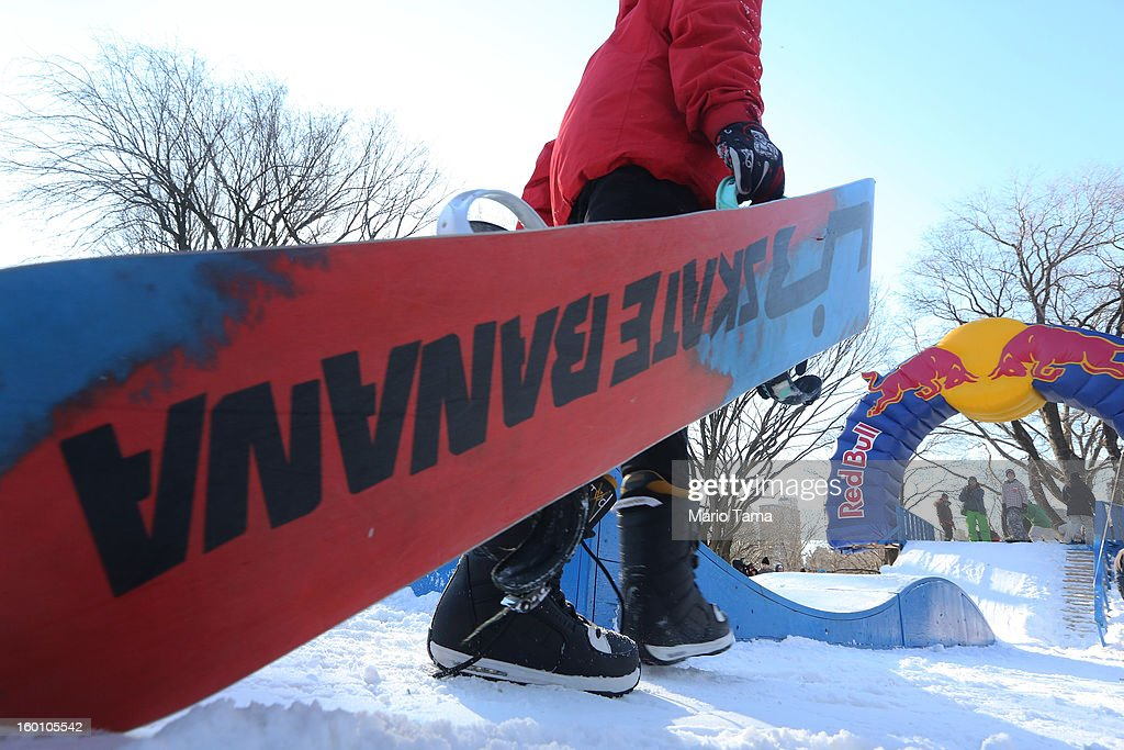 A man carries a snowboard at the Winter Jam in Central Park on January 26, 2013 in New York City. The annual festival brings skiing, snowboarding and snowshoeing to New Yorkers with free equipment.