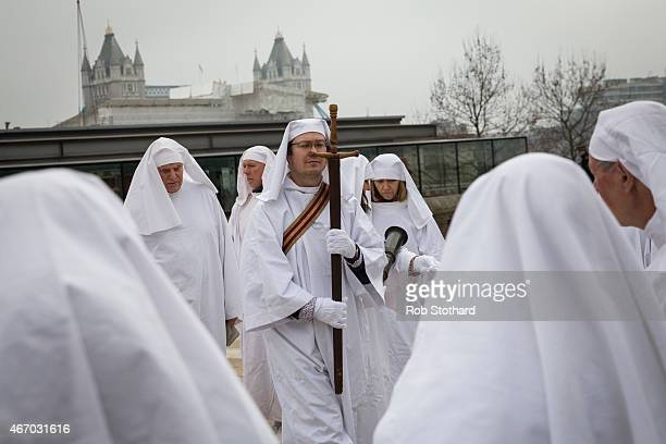 A man carries a sword as members of The Druid Order celebrate the Spring Equinox with a ceremony at Tower Hill on March 20 2015 in London England The...