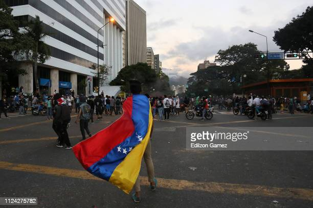 A man carries a Venezuelan flag during a protest against the government of Nicolas Maduro at Plaza Altamira after opposition leader and head of the...