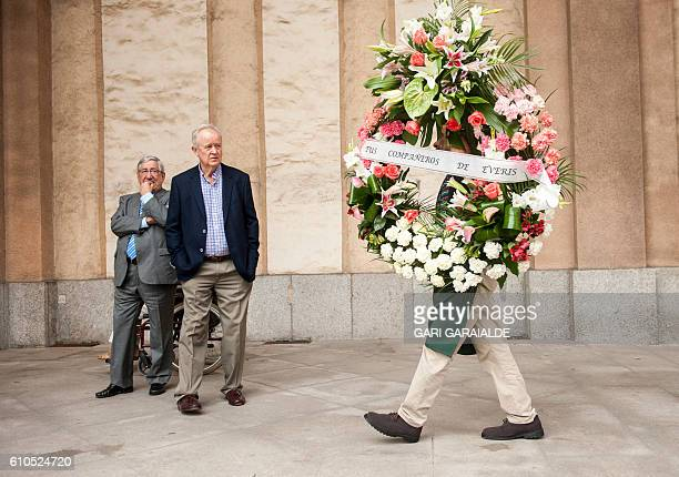 A man carries a wreath during funerals for Maria Villar Galaz niece of the president of the Spanish Football Federation Angel Maria Villar in the...