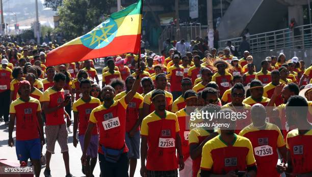 A man carries an Ethiopian flag during the Great Ethiopian Run at Adwa Square in Addis Ababa Ethiopia on November 26 2017 Total of 44000 professional...