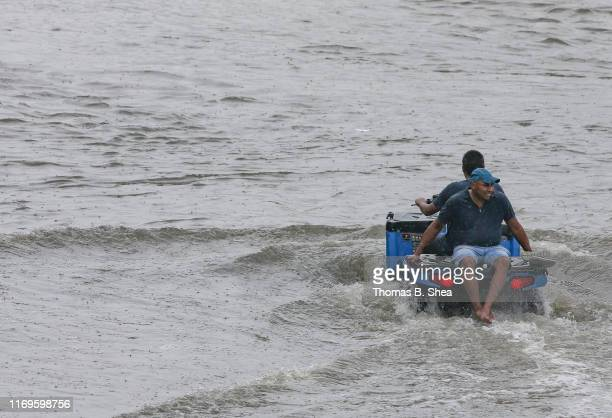 A man carries another man on an ATV through the flooded street of Little York on September 19 2019 in Houston TexasGov Greg Abbott has declared much...