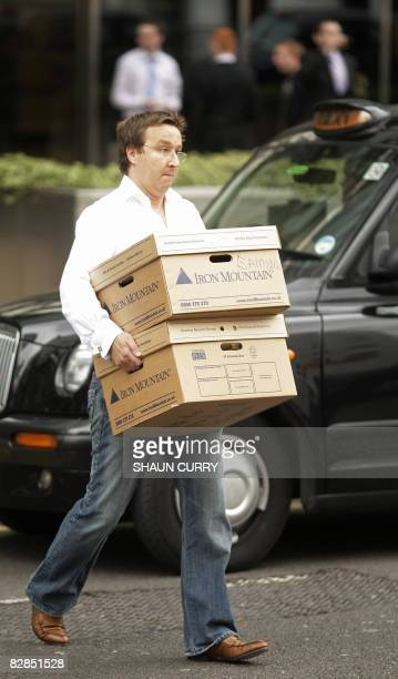 Man carries boxes as he leaves the Lehman Brothers European Headquarters building in Canary Wharf in east London on September 16, 2008. World...