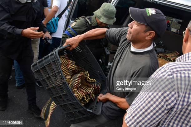 A man carries bullets close to the a airforce base La Carlota on April 30 2019 in Caracas Venezuela Through a live broadcast via social media...