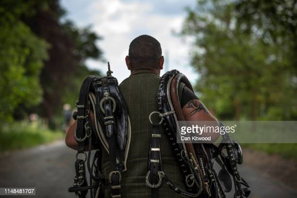 Man carries horse harnesses during the annual Appleby Horse Fair on June 07, 2019 in Appleby-in-Westmorland, England. The annual gathering for Gypsy,...