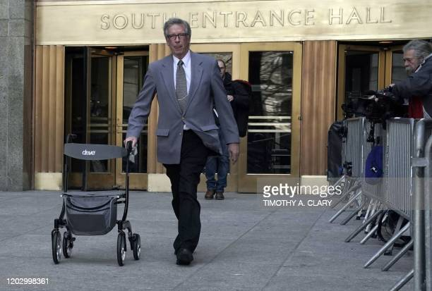 A man carries out the walker used by Harvey Weinstein in front of the Manhattan Criminal Court on February 24 2020 in New York City Harvey Weinstein...
