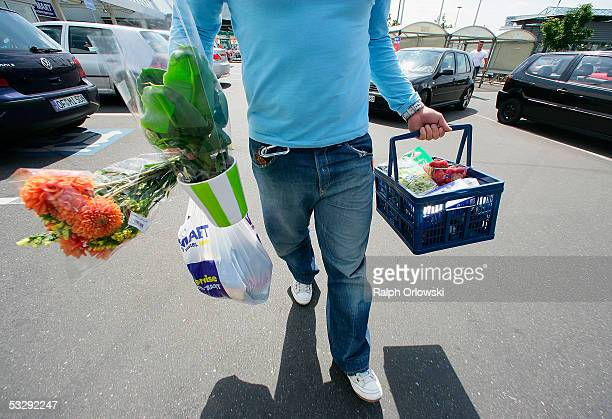 A man carries shopping bags July 26 2005 in Frankfurt Germany Sparked by the election manifesto of the opposition party CDU Germany is currently...