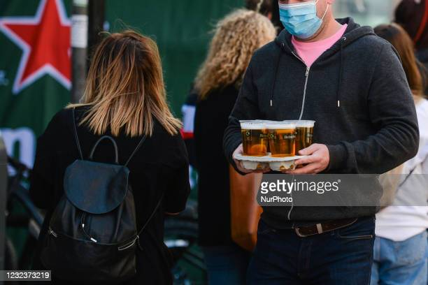 Man carries takeaway pints in Dublin city center, during the COVID-19 lockdown. On Saturday, 17 April 2021, in Dublin, Ireland.