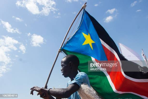 A man carries the South Sudan's national flag at Mangateen Internal Displaced persons center during the visit of South Sudan's Vice president in Juba...