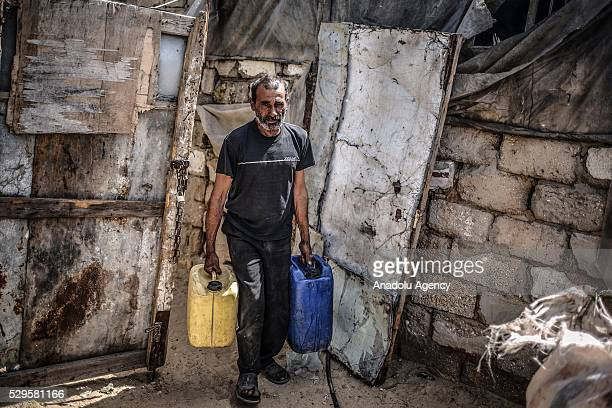 Man carries water buckets as Palestinians face a water crisis in Gaza City, Gaza on May 9, 2016. Palestinians use most of the Gaza's main water...