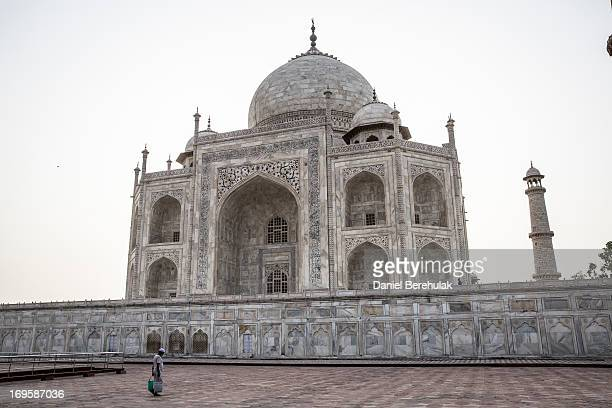 A man carrries buckets of water at the Taj Mahal on May 28 2013 in Agra India Completed in 1643 the mausoleum was built by the Mughal emperor Shah...