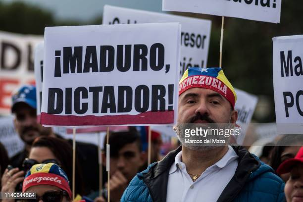 """Man carry a placard with the words 'Maduro murderer"""" during a protest against Venezuelan president Nicolas Maduro and supporting Juan Guaido...."""