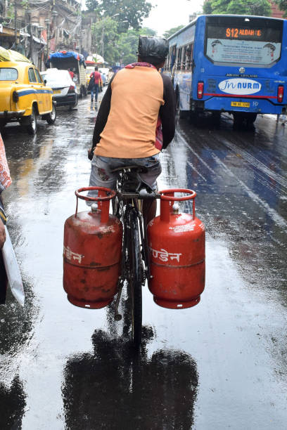 A Man carry Subsidised LPG cylinder during Subsidised LPG cylinder price to spike post GST on July 052017 in KolkataIndiaDomestic cooking gas price...
