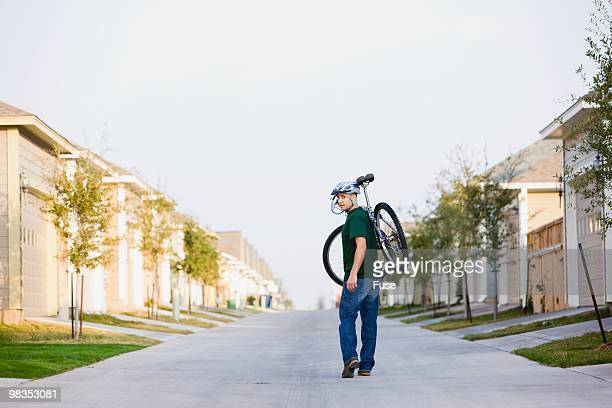Man carrying a bicycle