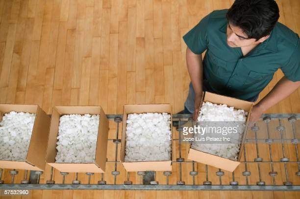Man carrying a box full of styrofoam