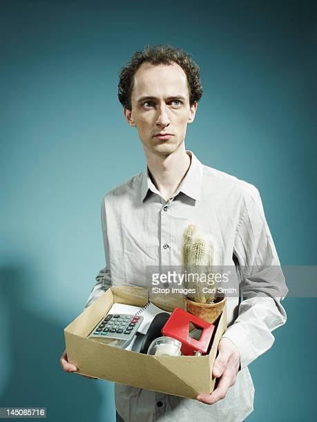 a man carrying a box of possession after being fired - being fired stock pictures, royalty-free photos & images