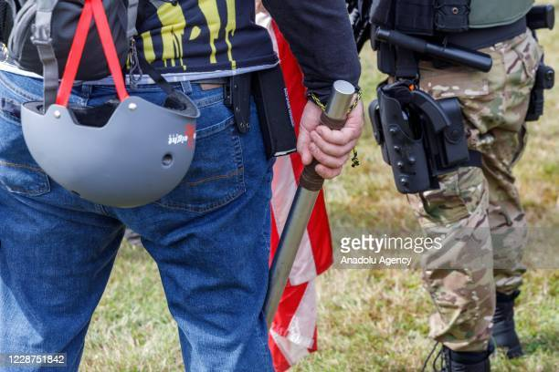A man carrying a club is seen as the Proud Boys a rightwing proTrump group gather with their allies in a rally called âEnd Domestic Terrorismâ...