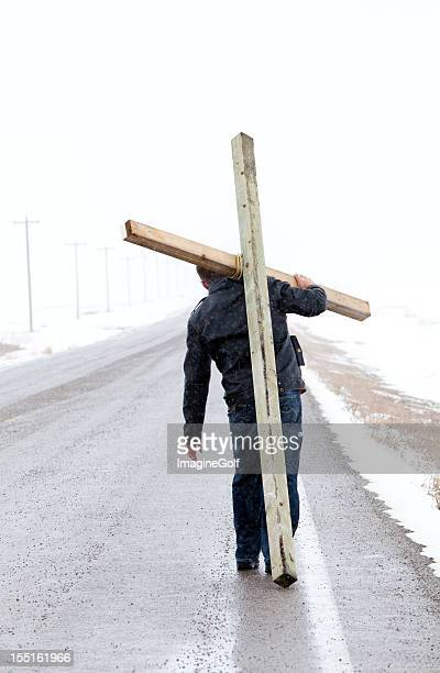 man carrying a cross at easter - easter cross stock pictures, royalty-free photos & images