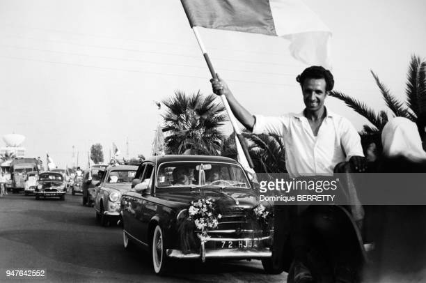 Man carrying a flag in the street of Algeria