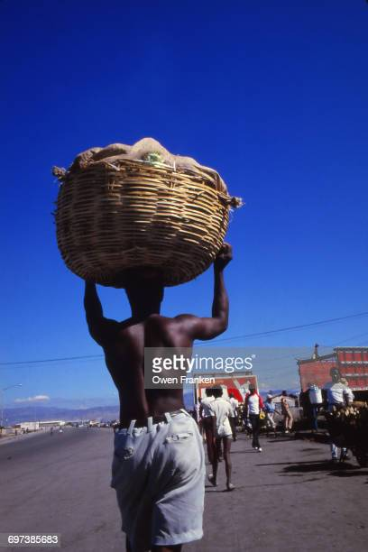 man carrying a heavy load