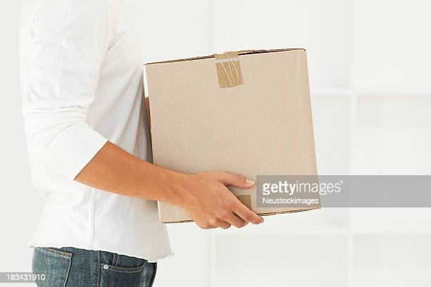 Man Carrying a Moving Box