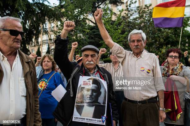 A man carrying a picture of a missing relative protesting in front of the Congress of Deputies against impunity of crimes during Franco's...