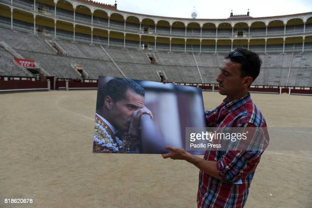 A man carrying a picture of Spanish bullfighter Ivan Fandiño who died after being gored by a bull on last June 17 2017 after of a funeral mass at...