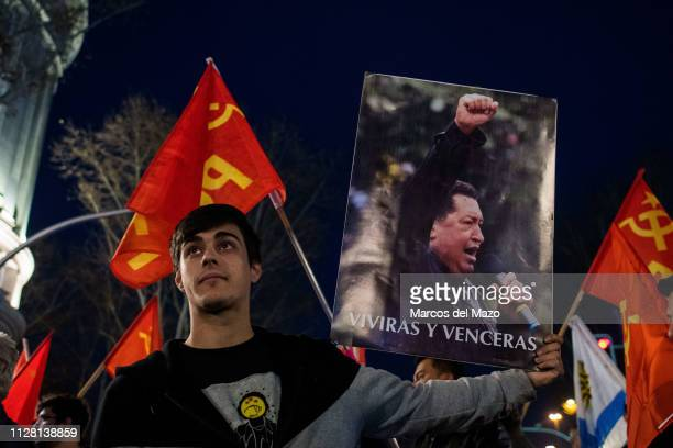Man carrying a placard with the picture of Venezuelan president Nicolas Maduro, protesting under the slogan 'No to war, no to the coup in Venezuela'.