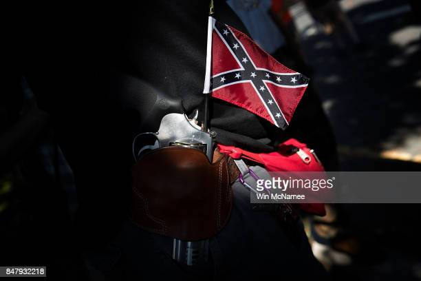 A man carrying a sidearm and confederate flag attends a protest held by the Tennessee based group New Confederate State of America September 16 2017...